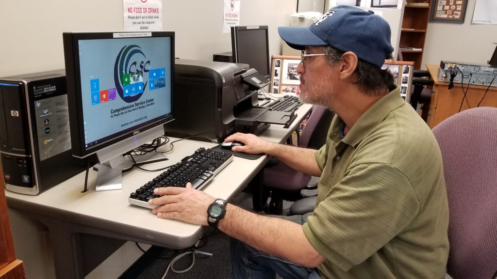 Ernest uses one of our community desktop computers.
