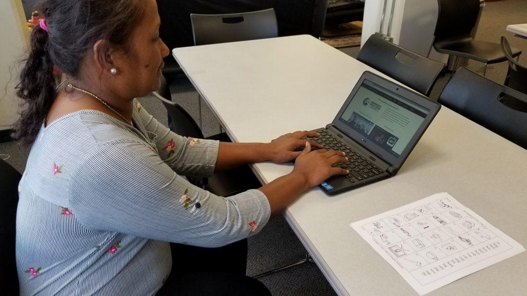 Joyce using a Chromebook laptop.