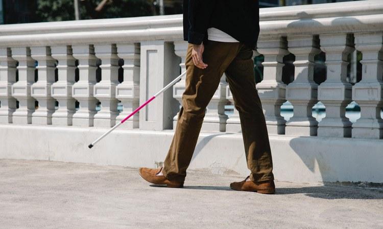 Photo: Deaf-Blind Person Walking
